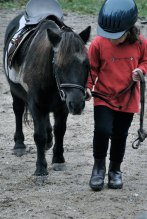 A girl and her rented and tiny pony