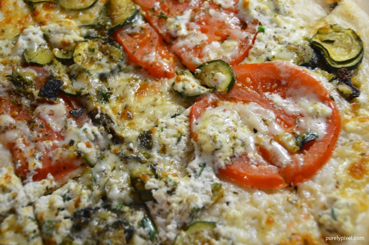 Veggie Special: Herb ricotta cheese with sliced vine ripened tomatoes from Maddison, ME and organic fire-roasted organic zucchini topped with whole milk mozzarella, parmesan and hand cut herbs.