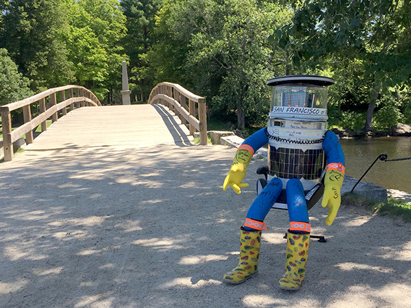 hitchBOT visits the Old North Bridge, Concord, MA. (Photo by Tracy McArdle Brady)